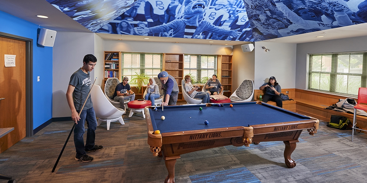 students enjoying the game room in the community center