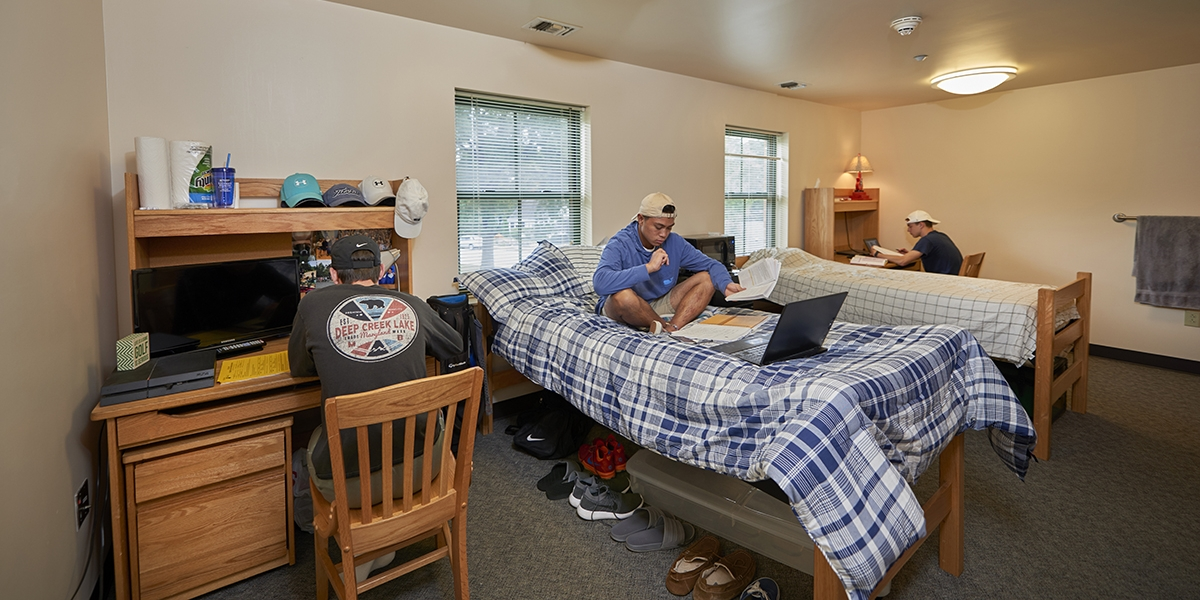 male students studying in FY double room
