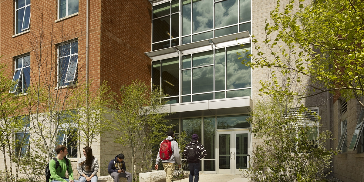 Students walk into Juniata Hall on the Penn State Harrisburg campus. Copyright Halkin Photography.